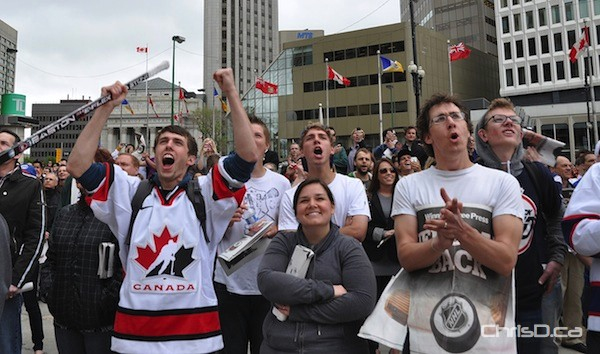 Fans cheer in the courtyard of 201 Portage Avenue as they watch the announcement being made that the NHL is returning to Winnipeg on Tuesday, May 31, 2011. (MAURICE BRUNEAU / CHRISD.CA)