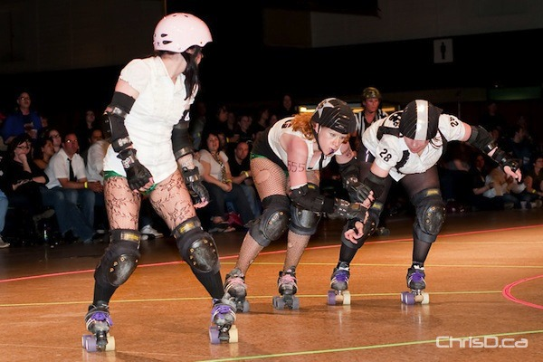 Ladies of the Winnipeg Roller Derby League battle it out at the Winnipeg Convention Centre on Saturday, April 30, 2011. (TED GRANT / CHRISD.CA)