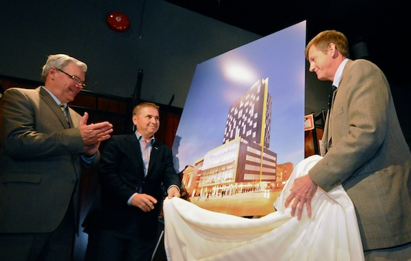 Manitoba Premier Greg Selinger applauds as Jean-Yves Germain of Groupe Germain and Jeoffrey Chipman, CEO of Longboat Development Corp., unveil a massive redevelopment project for downtown Winnipeg.  (JAMES TURNER / METRO NEWS)