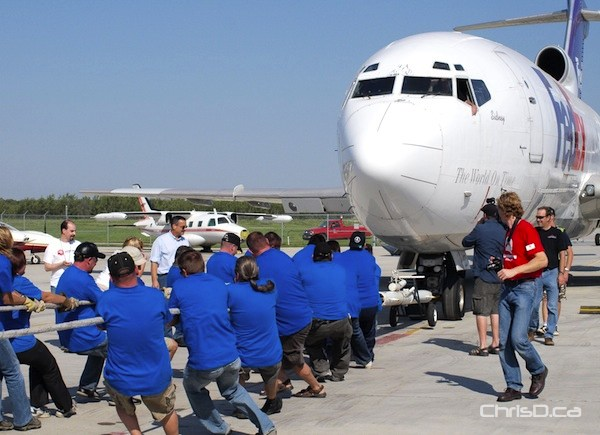 A team participates in United Way's annual Plane Pull event in this file photo. (CHRISD.CA)
