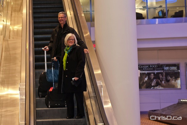 Rodger and Linda Chaput were the first passengers to arrive at the new airport on Sunday, October 30, 2011. (TED GRANT / CHRISD.CA)