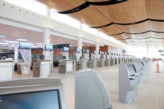 Passenger check-in kiosks at the new airport terminal building. (WAA)