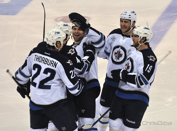 The Winnipeg Jets celebrate a goal scored by defenceman Zach Bogosian (4) against the Anaheim Ducks during the third period at MTS Centre on Saturday, December 17, 2011. (MAURICE BRUNEAU / CHRISD.CA)