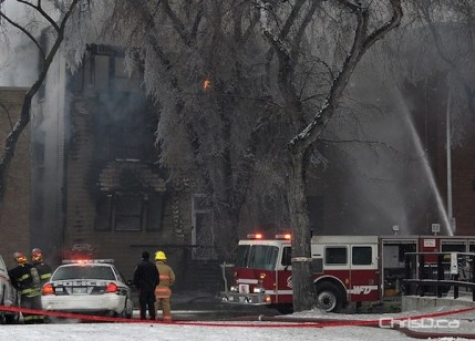 Firefighters put out hotspots at an apartment block on Sherbrook Street on Saturday, January 14, 2012. (MAURICE BRUNEAU / CHRISD.CA)