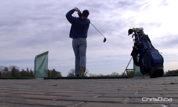 A golfer takes a swing at the driving range at Shooters Family Golf Centre on Wednesday, March 14, 2012. (CHRISD.CA)