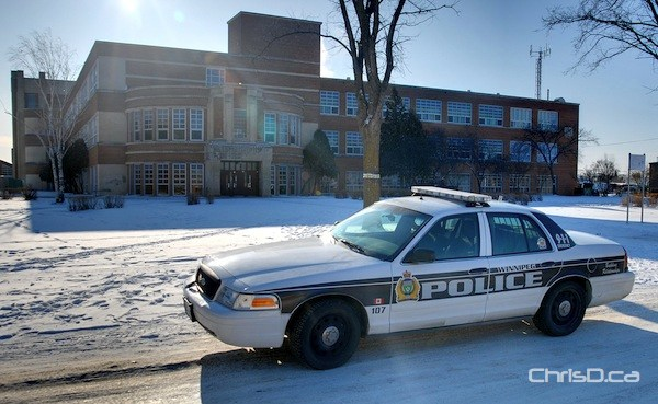 A Winnipeg police cruiser sits in front of Tec Voc High School in this January 2012 file photo. (STAN MILOSEVIC / CHRISD.CA)