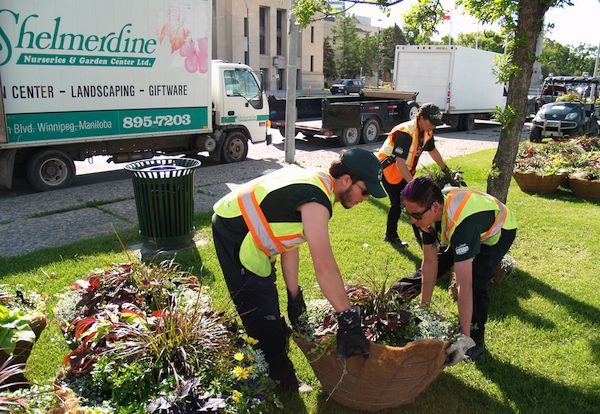 Workers with the Downtown Winnipeg BIZ prepare flower baskets to be placed along Portage Avenue. (HANDOUT)