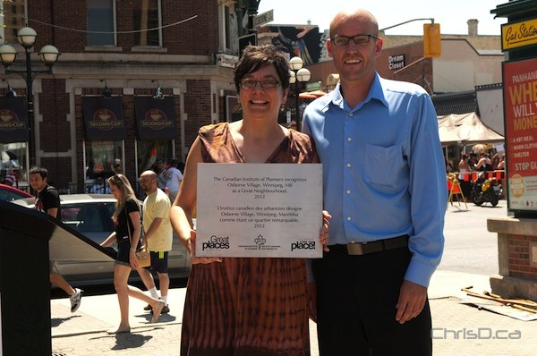 City councillor Jenny Gerbasi and Donovan Toews of the Canadian Institute of Planners during the plaque ceremony in Osborne Village on Sunday, July 1, 2012. (TED GRANT / CHRISD.CA)