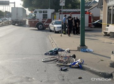 Emergency personnel tend to the scene of a crash involving a cyclist on Monday. (STAN MILOSEVIC / CHRISD.CA)