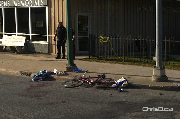 A bicycle lies at the corner of Notre Dame Avenue at Keewatin Street after a crash involving a vehicle on Monday, September 10, 2012. (STAN MILOSEVIC / CHRISD.CA)