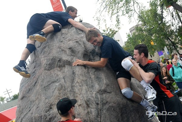 University of Winnipeg students climb a 25-ton granite rock outside of Wesley Hall on Friday, September 7, 2012. (STAN MILOSEVIC / CHRISD.CA FILE)
