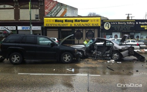 Two vehicles sit damaged on Portage Avenue at Furby Street following a crash on Monday, October 8, 2012. (DAVID PERICH / FOR CHRISD.CA)