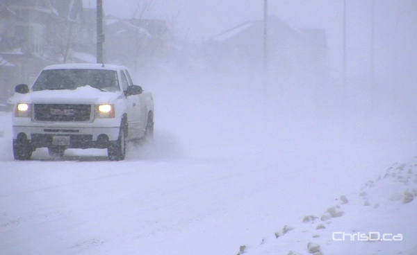 A pickup truck travels in blistery conditions in Winnipeg on Saturday, November 24, 2012. (CHRISD.CA)