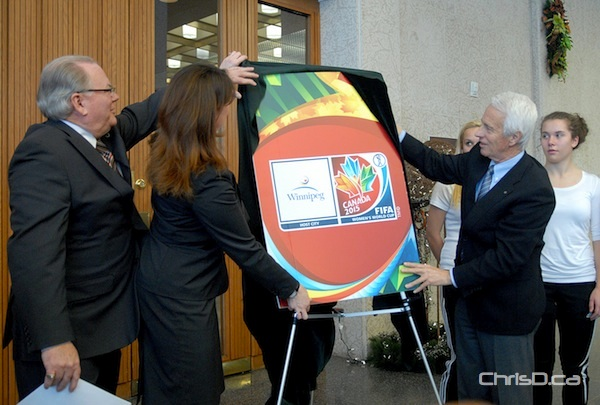Walter Sieber of the Canadian Soccer Association (right) unveils the emblem for the FIFA Women's World Cup Canada 2015, along with Councillor Grant Nordman and MLA Erin Selby at City Hall on Friday, December 14, 2012. (STAN MILOSEVIC / CHRISD.CA)
