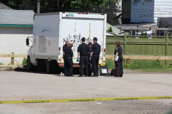 Police at the scene where a man's body was found in St. Boniface on Sunday, June 2, 2013. (METRO WINNIPEG/SHANE GIBSON)