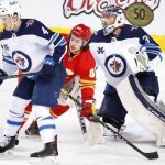 Jets Clinch Playoff Spot with 4-0 Win Over Flames