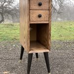 "A 31"" tall, 9"" wide, 18"" deep nightstand made of red oak."