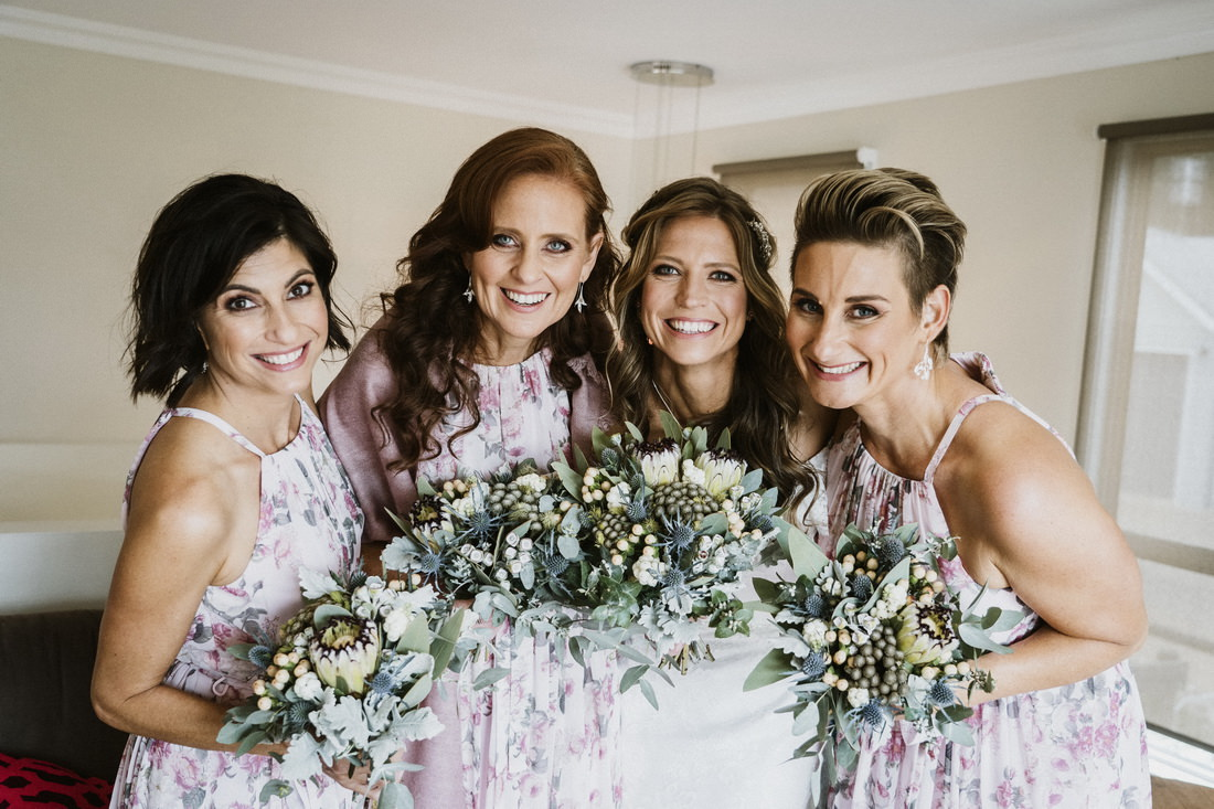 Gorgeous wedding photography of the bride and her bridesmaids