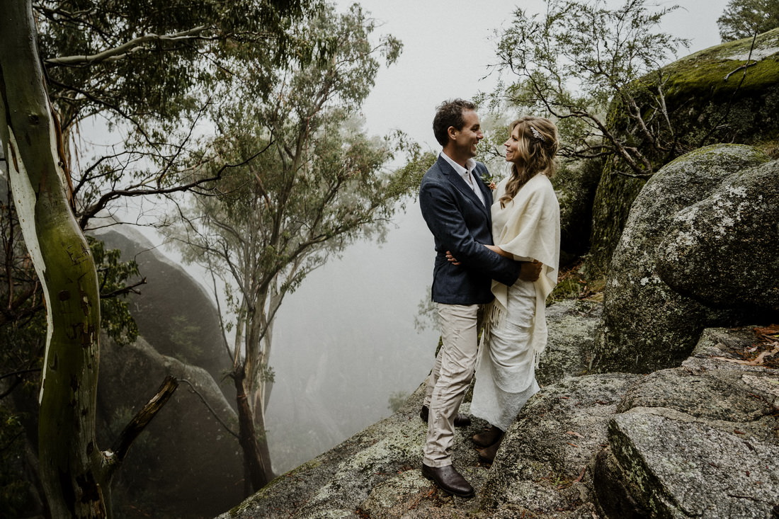 Wedding photography of bride and groom next to a cliff by Mt Beauty wedding photographer