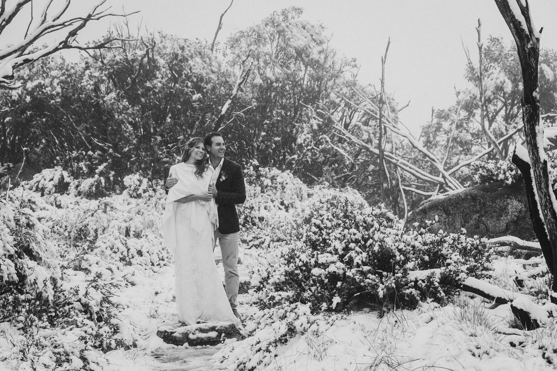 Bride and groom hugging on the top of mt buffalo by Bright Wedding Photographer