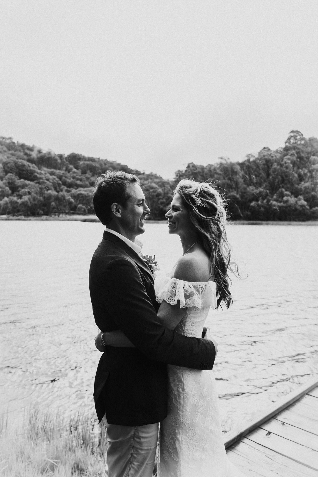 Black and white photo of bride and groom at a lake at Mount Buffalo by Mt Buffalo Wedding Photographer