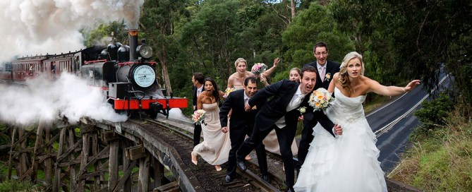 Melbourne wedding photographer photographing bridal party on train tracks in the dandenong ranges