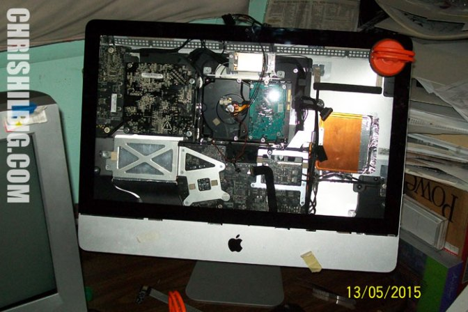 An iMac without an LCD screen with its guts exposed.