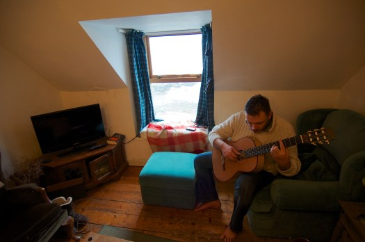 Playing Christopher's guitar