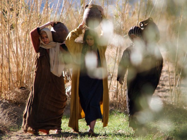 Women bringing spices