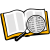 Magnifying glass over Bible - top view