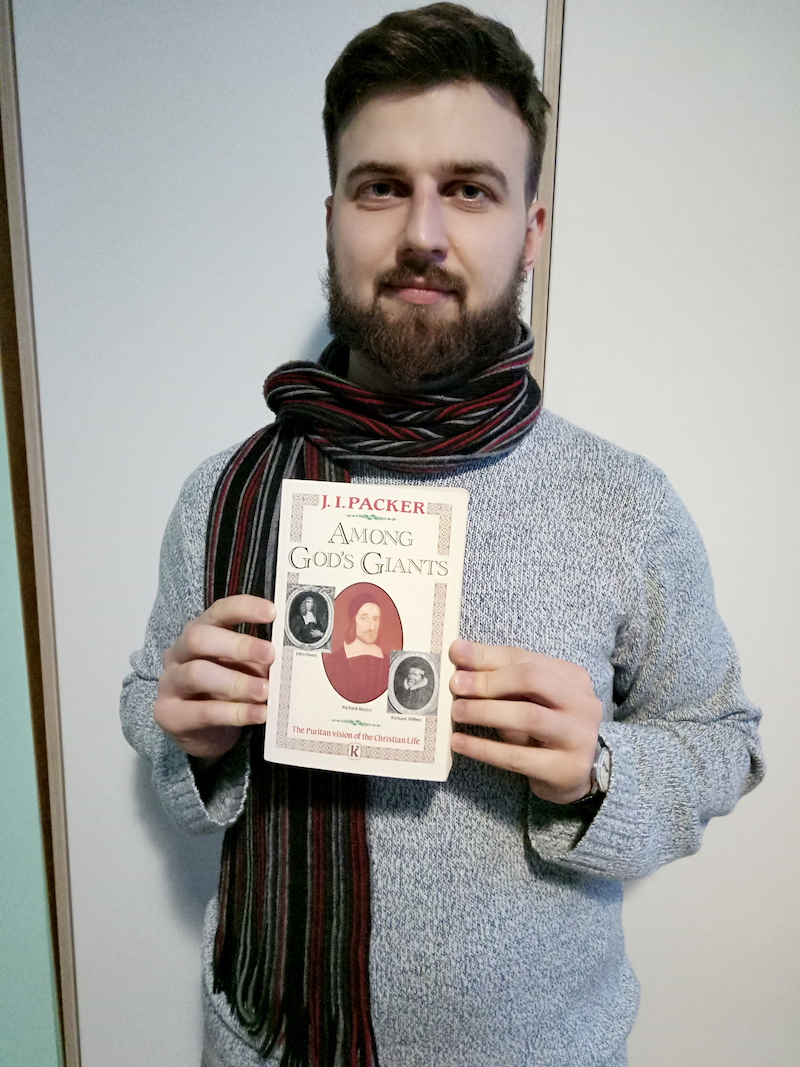 Ukrainian pastor with book on Puritans