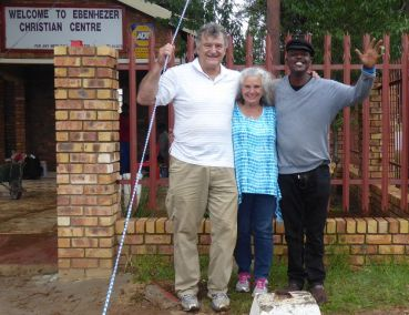 Pastors Bill and Carol with  Sechaba Molefe who is Pastor Molefe's grandson. He recently moved from Detroit, Michigan, to help his grandfather in ministry