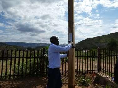 Pastor Chimunhu attaching plaque