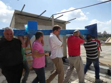 Carrying the Cross up to the roof of the school