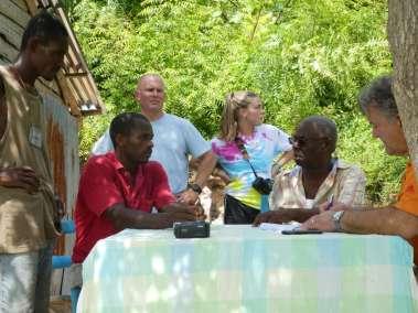 Pastor Bill interviews Deacon Michele Miller in red.