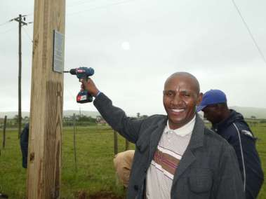 Reverend Motebele attaching plaque
