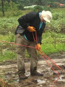 Tieing off Cross in Pouring Rain