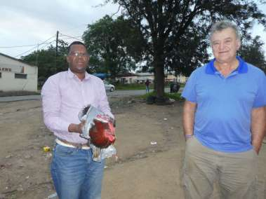 Pastor Noti Gives A Gift Of A Live Chicken