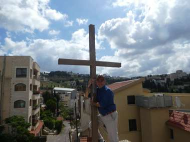 Rev. Saad Hugging Cross