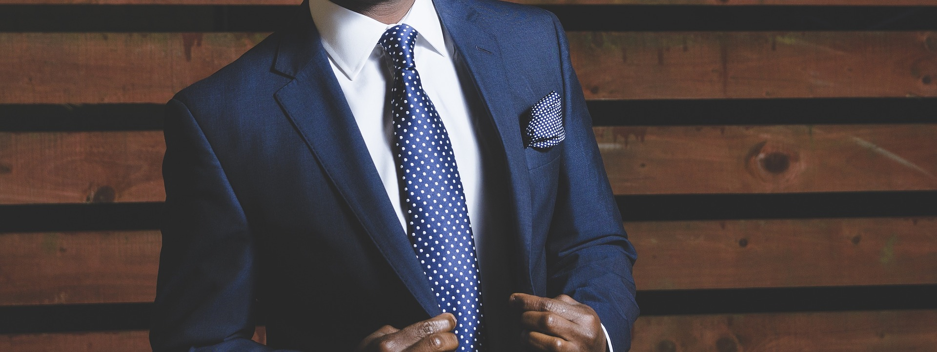 Featured Image for about page. Man in suit.