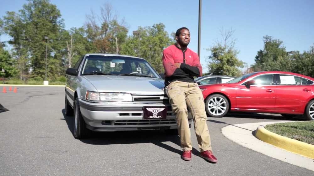 "Morris and ""The Bentley,"" a 1991 Mazda 626 he bought for $2 from his pastor while he was in college. (Courtesy Team Mazda)"