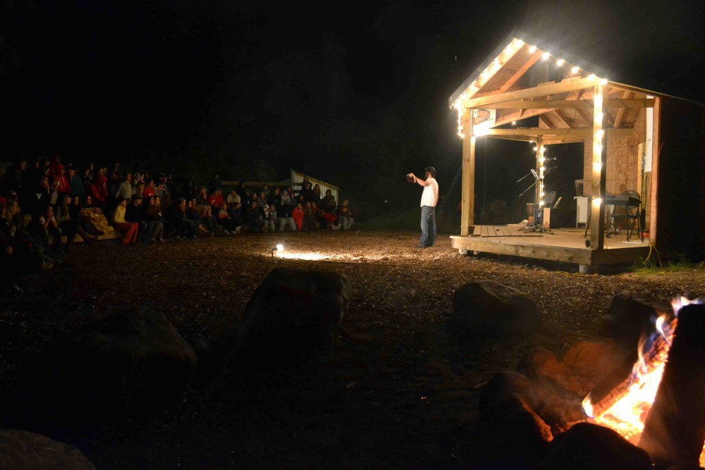Campers gathering around the camp fire for a preaching time at Circle Square Ranch Arden. Photo courtesy Circle Square Ranch.