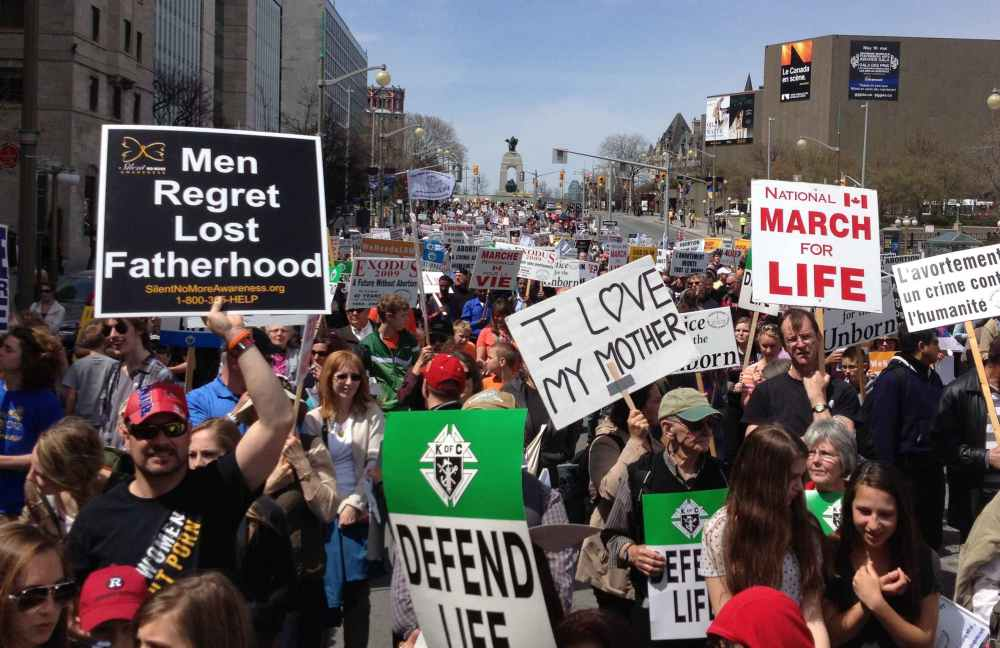 Pro-lifers march past the National War Memorial at the 2014 March For Life. Photo by Craig Macartney.