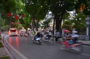 Vietnam's bustling red lanterns and fast motorbikes