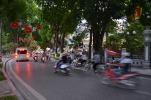 Vietnam's bustling red lanterns and fast motorbikes