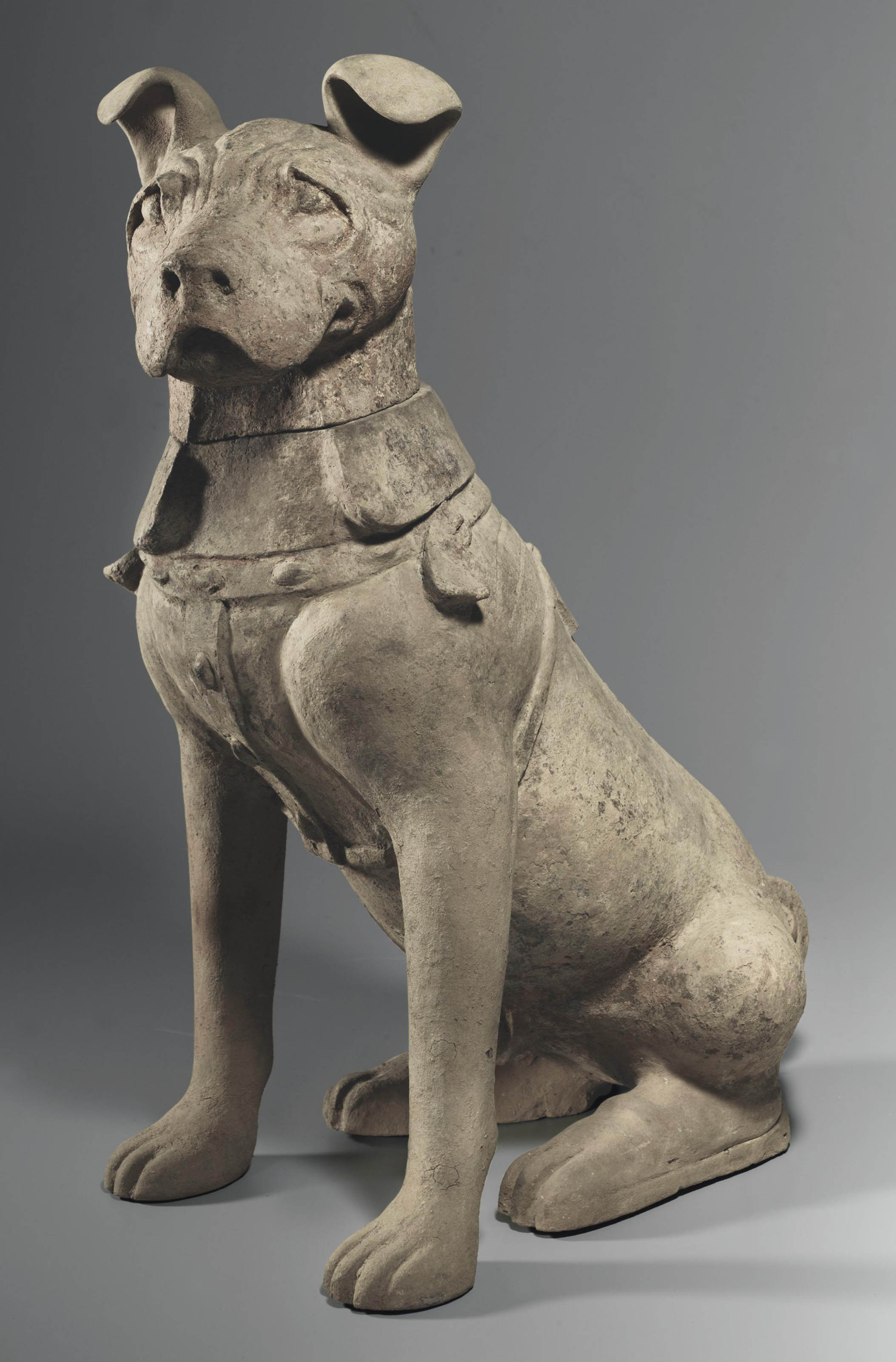 A Large Grey Pottery Figure Of A Male Guard Dog Han
