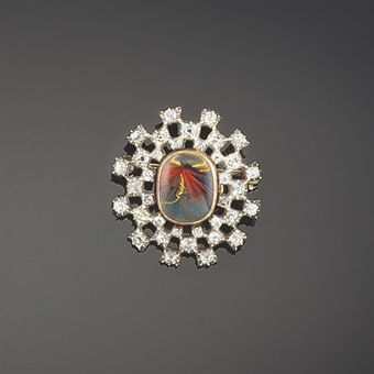 An early 19th century diamond locket brooch