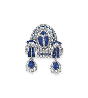 AN ART DECO DIAMOND AND SAPPHIRE BROOCH