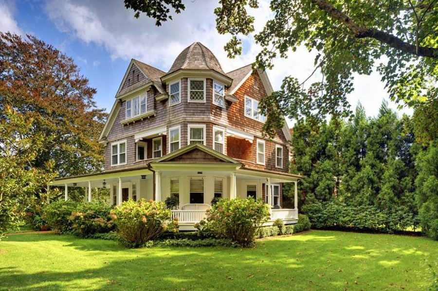 An elegant 1903 estate in East Hampton has a 900-square-foot wraparound porch, big enough for a summer dinner party.