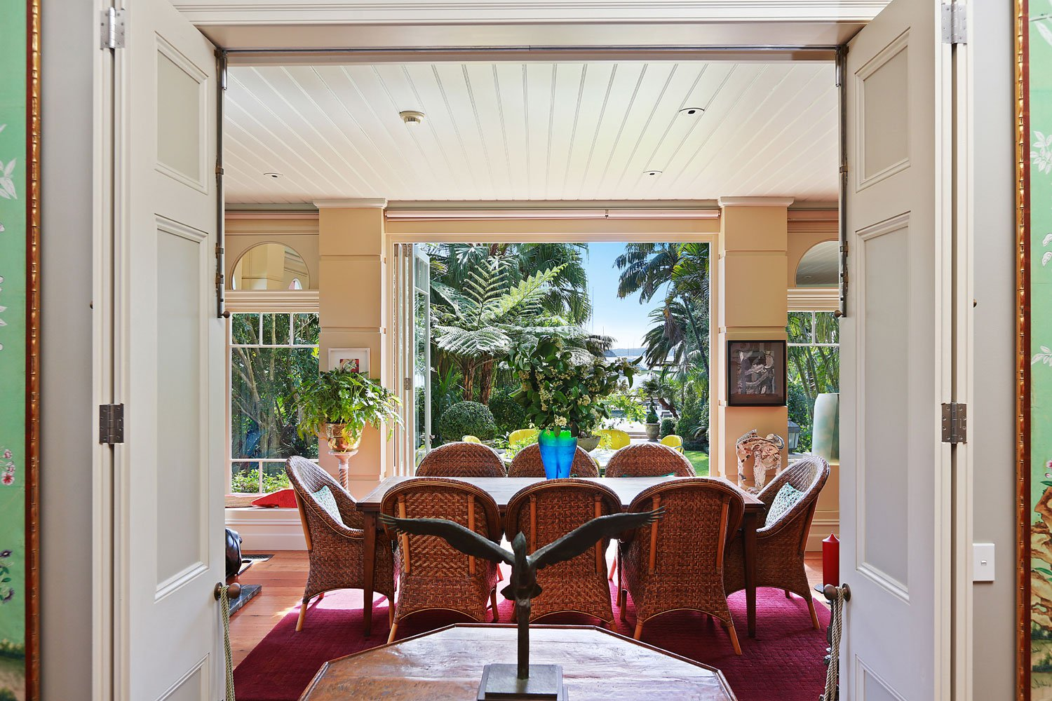 The home's openness is evident in this airy view through the lounge room to the yard and bay beyond.